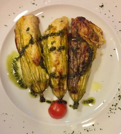 sautéed zucchini flowers stuffed with herbed ricotta and drizzled with basil pesto
